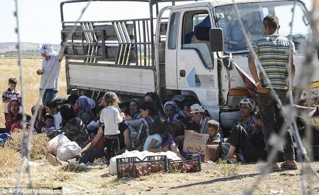 Thị trấn Syria rơi vào tay IS, thảm kịch đẫm máu liên tiếp xảy ra - anh 4