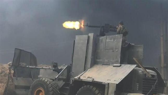 Tội ác kinh hoàng của IS: Dùng xe ủi cán chết 12 thường dân Iraq - anh 1