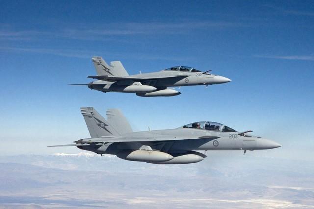 Australia lần đầu không kích IS dữ dội tại Syria - anh 1