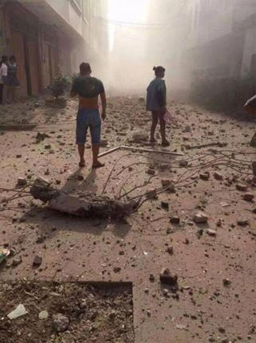 Hiện trường nát vụn sau vụ nổ bom liên hoàn ở Trung Quốc - anh 7