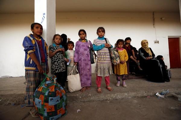 Thế 'tiến thoái lưỡng nan' của người dân tại chảo lửa Mosul  - ảnh 1
